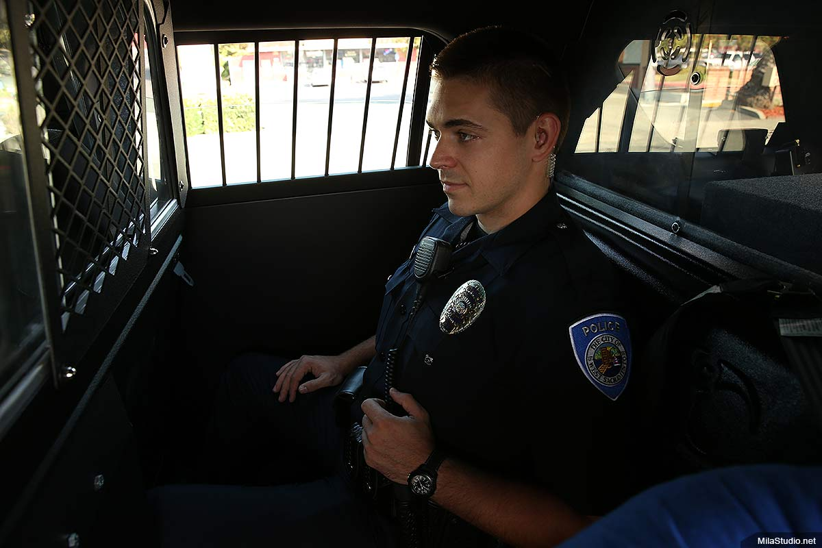police-officer-on-the-back-seat-car
